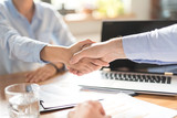 Business people shaking hands. Finishing up meeting. - 180345835
