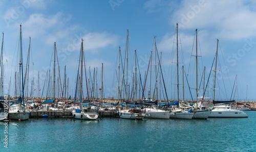 Plexiglas Zeilen moored sailing ships at the pier