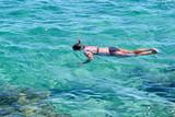 Beautiful women snorkeling in the tropical sea - 180358245