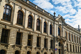 The facade of the historic building of the university library in Poznan. - 180364227