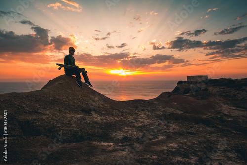 Fotobehang Skateboard Skater boy at sunset
