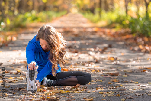 Fotobehang School de yoga Woman exercising on autumn trail