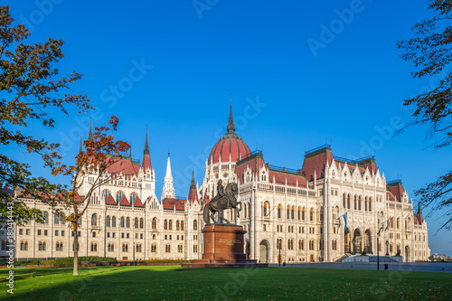 Fotobehang Boedapest Budapest, Hungary - The Hungarian Parliament at early in the morning with the horse statue of Ferenc Rakoczi. Clear blue sky