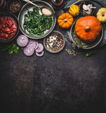 Food background for healthy vegetarian cooking ingredients for tasty pumpkin dishes recipes in bowls : tomato sauces, spinach, sliced onion, pumpkin seeds, top view, banner. Clean seasonal eating - 180419229