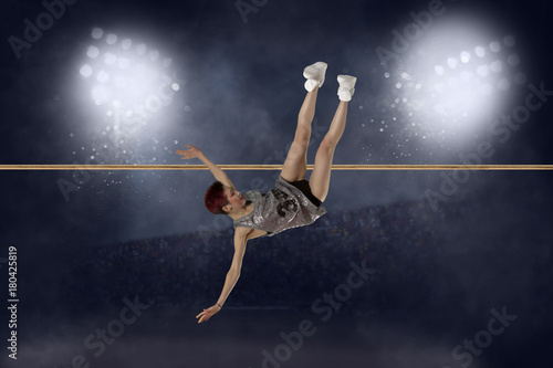 Poster Woman in action of high jump