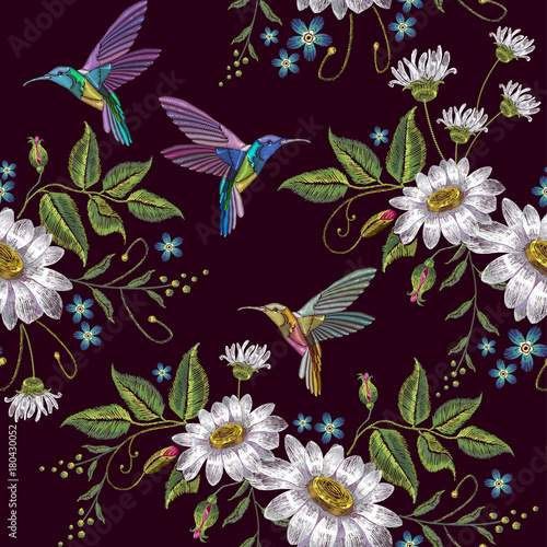 Humming bird and chamomile embroidery seamless pattern. Template for clothes, textiles, t-shirt design. Beautiful hummingbirds and white chamomile embroidery on black background - 180430052