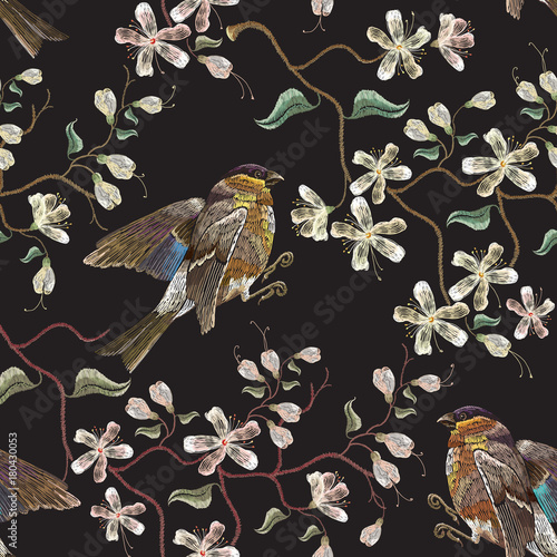 Embroidery birds and blossoming white cherry seamless pattern. Classical embroidery titmouse birds on branch blossoming sakura. Spring fashion pattern, template clothes, t-shirt design - 180430053