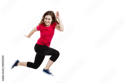Fotobehang Hardlopen Young woman jumping on white background