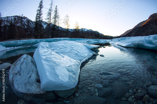 glacier ice melts in the spring on the river in the mountains