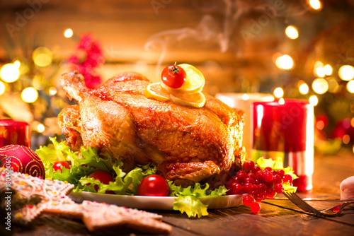 Christmas holiday dinner. Served table with roasted turkey - 180440065