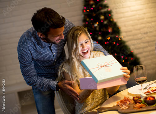 Young couple with present at Christmas time