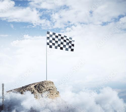 Checkered flag on mountain top