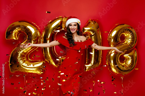 New Year Party. Woman In Santa Hat Having Fun With Balloons Poster