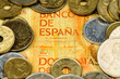 Spanish pesetas bank note and coins
