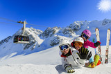 Happy family enjoying winter vacations in mountains . Ski, Sun, Snow and fun. - 180482255