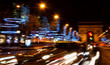 Paris. Blurred photo of Arch of Triumph and Champs Elysees with Christmas festive illumination. Blurry cars in motion.