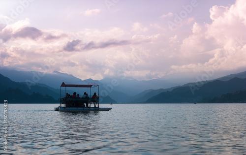 Fotobehang Purper Lake in the Pokhara at sunset
