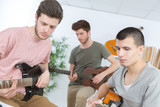 Young men playing guitars - 180493826