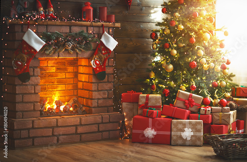 Leinwandbild Motiv interior christmas. magic glowing tree, fireplace, gifts