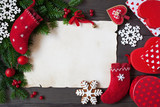 Christmas letter, list, congratulations on a wooden background, gift boxes, sock and fir branches - 180495047