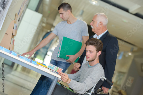 Poster students in business class with trainer