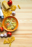 Italian minestrone soup with pasta recipe, flatlay with ingredients - 180502602