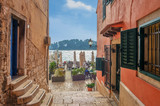 Romantic Rovinj street with a sea view.Idyllic street with old houses in town of Rovinj, Istria, Croatia - 180510844