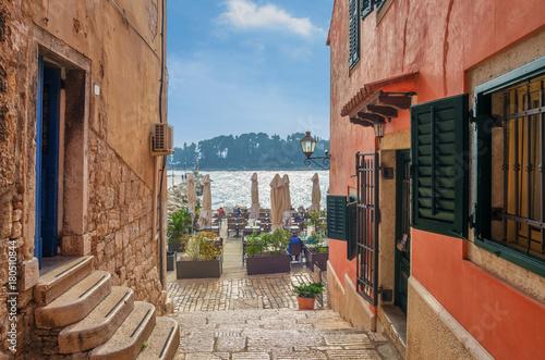 Romantic Rovinj street with a sea view.Idyllic street with old houses in town of Rovinj, Istria, Croatia