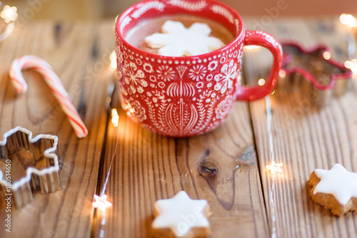 Deurstickers Chocolade Cozy cup of hot cocoa with snowflake shaped marshmallow