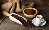 Coffee beans, ground coffee powder and cup of espresso
