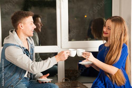 Fototapeta loving couple is drinking tea