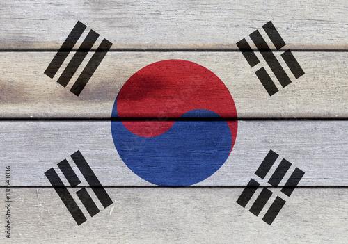 Fotobehang Seoel Kingdom of South Korea flag on wooden surface