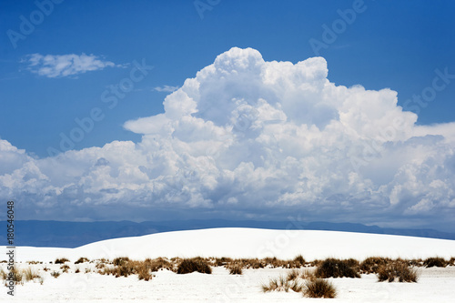 Fotobehang Bleke violet Blue sky and clouds and white sand on White Sands National Monument in New Mexico