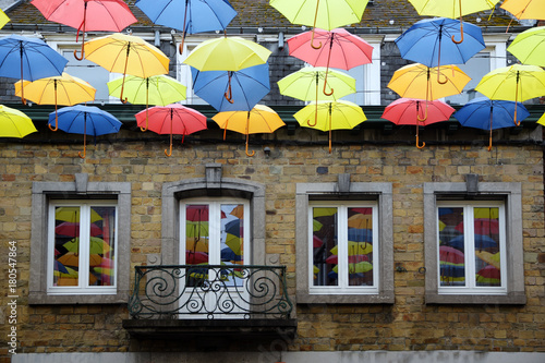 Juliste colorful hanging umbrellas, decoration in the shopping street in the old town of