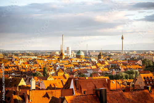 Cityscape view on the old town of Nurnberg city during the sunset in Germany Poster