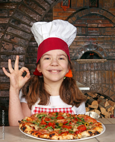 Staande foto Pizzeria happy little girl cook with pizza fast food and ok hand sign