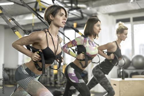 Sticker Sportive girls training in gym