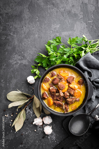 Meat stew, goulash in a cast iron pot, top view - 180561085