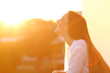 Leinwanddruck Bild - Woman breathing at sunset in a balcony
