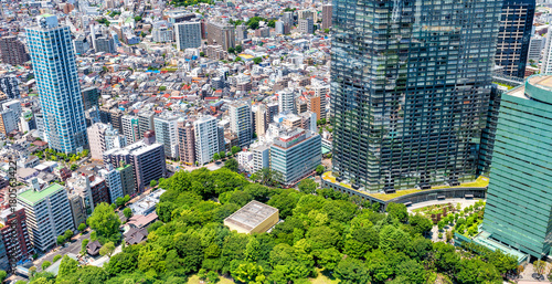 Plexiglas Tokio TOKYO - MAY 2016: City aerial skyline. Tokyo attracts 20 million tourists every year