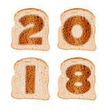 2018 greeting card on toasted slices of bread isolated on white background - 180567410