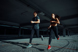 Young sports couple running in the urban environment - 180567811