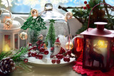 christmas  decoration with winter scene in glass dome and lanterns