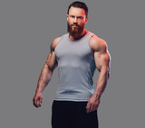 Bearded bodybuilder dressed in a tank top. - 180576252