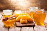 various types of honey in glass jars