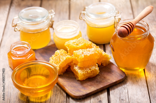 various types of honey in glass jars