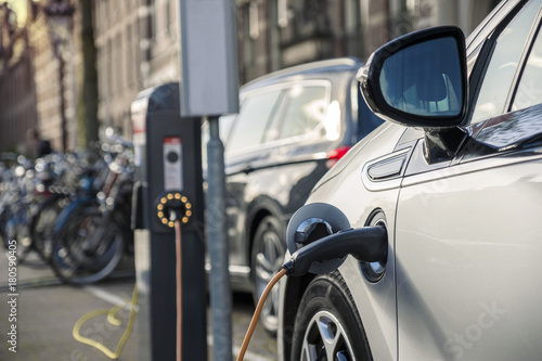 Charging an electric car in public station - 180590405