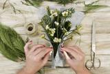 woman arranging a bunch of mistletoe - 180592015