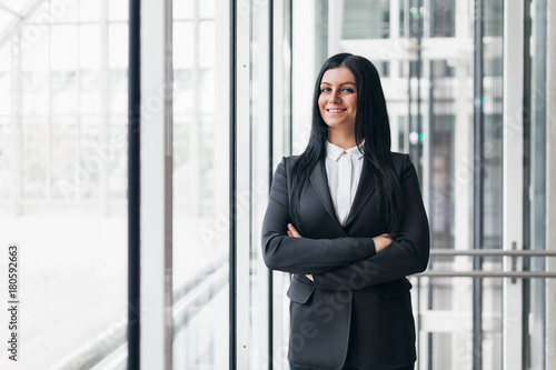 Sticker Successful confident business woman in an office setting