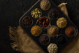 Indian Spices / Masala Box on a Black Background. With Jute. - 180596830